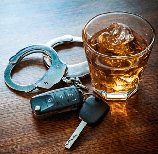 Handcuffs next to alcoholic beverage and car keys